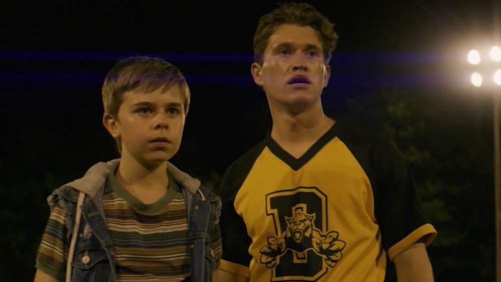 Joe (Alexander Elliot) and Frank Hardy (Rohan Campbell) stand on a baseball field in The Hardy Boys