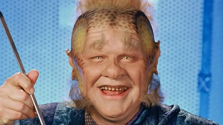 Neelix smiling while cooking