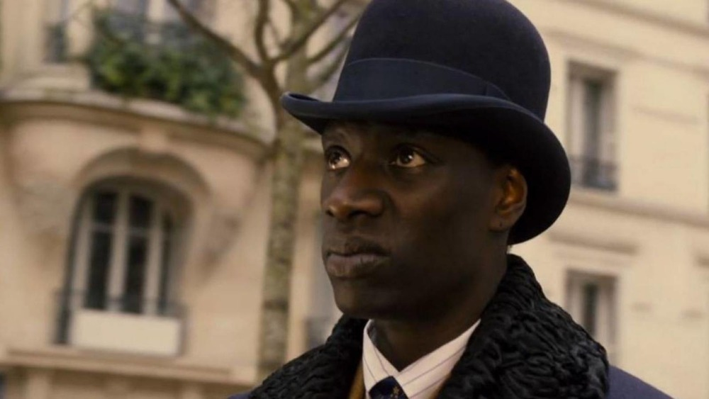 Lupin Omar Sy in a bowler hat