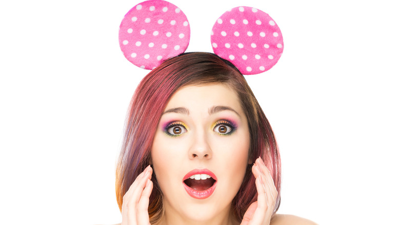 Surprised model wearing Mickey Mouse ears