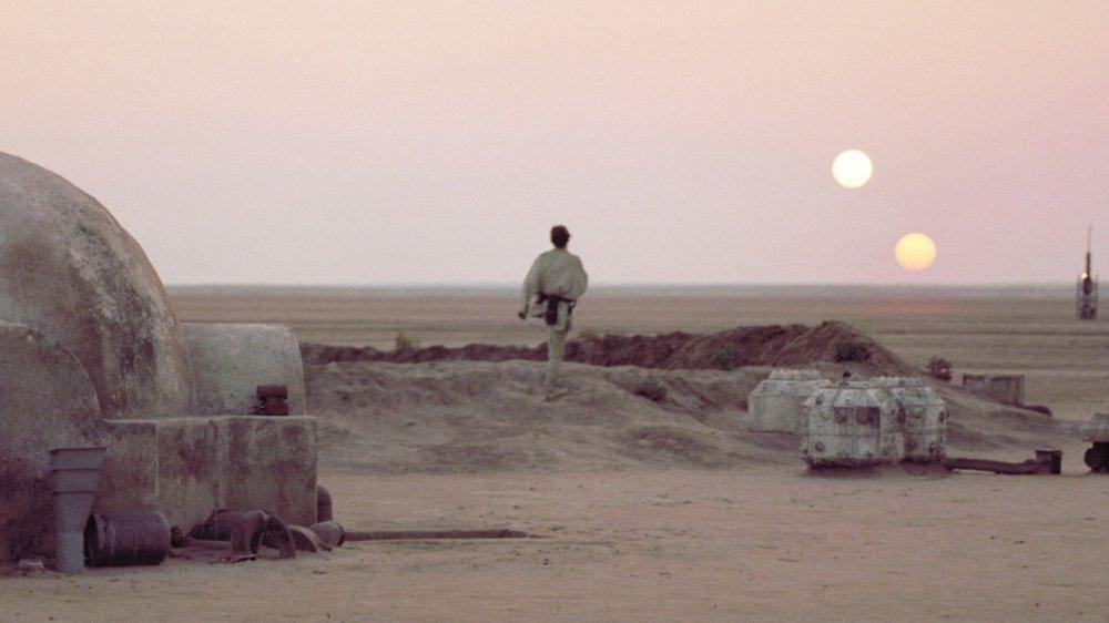 Luke Skywalker takes in Tatooine's binary sunset
