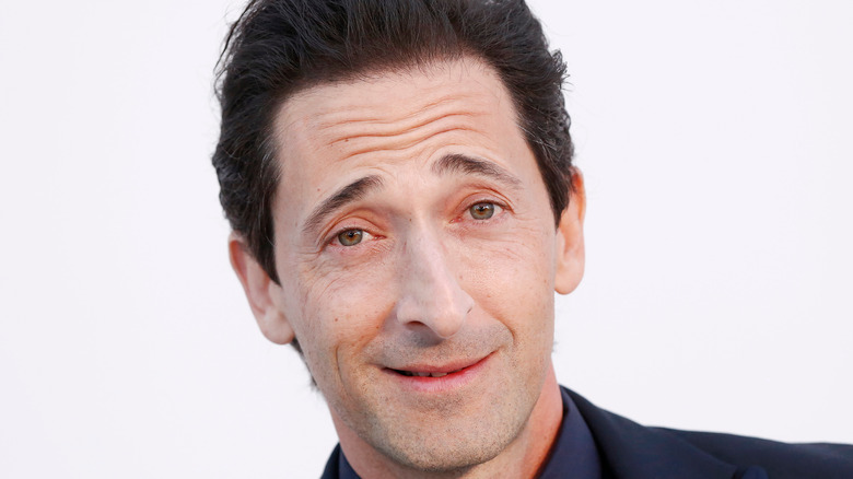 Adrien Brody poses at event