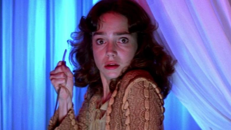 Suspiria girl holding a knife