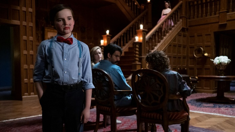 Benjamin Evan Ainsworth as Miles and cast on Netflix's The Haunting of Bly Manor