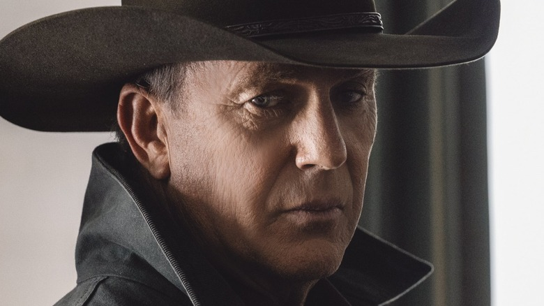 Kevin Costner in character as John Dutton wearing cowboy hat