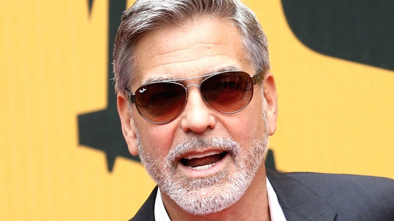 George Clooney posing at event