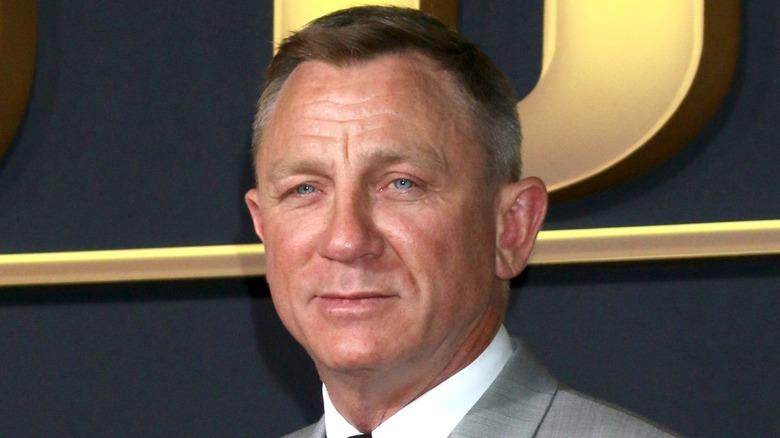 Daniel Craig smiling at event