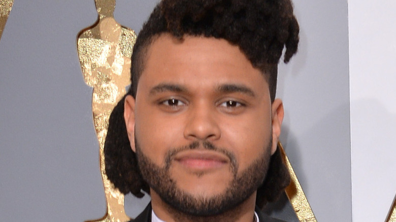 The Weeknd posing at Oscars