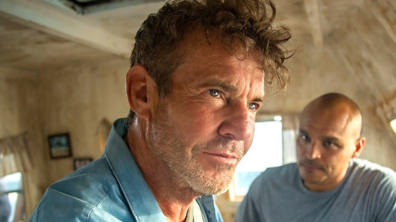 Jimmy Gonzales staring and Dennis Quaid smiling