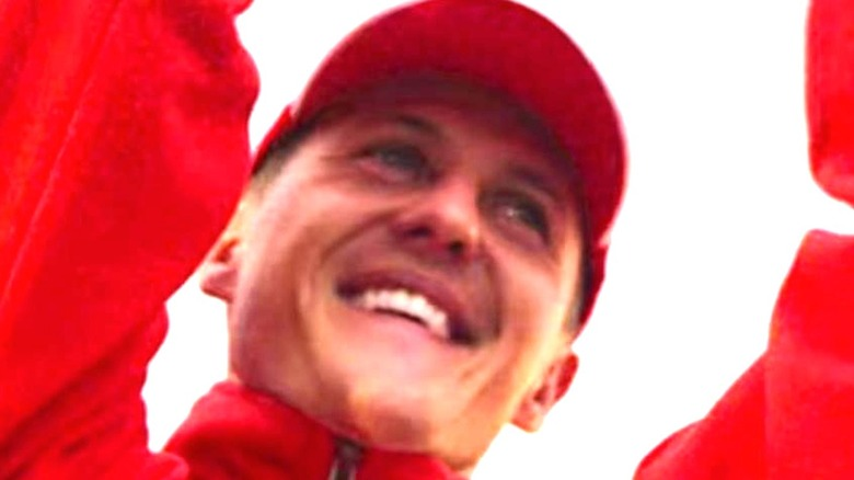 Michael Schumacher with arms raised