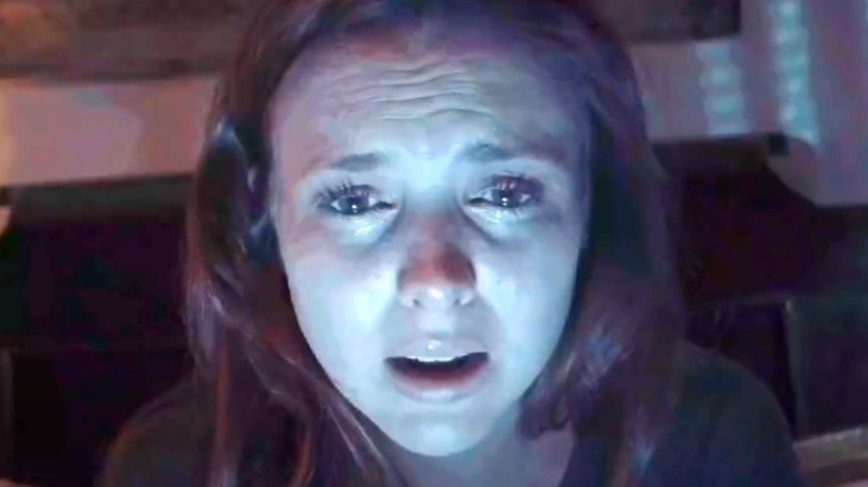 Crying frightened woman