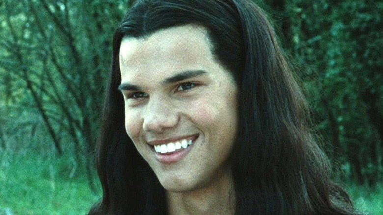 Jacob Black with long hair in the forest