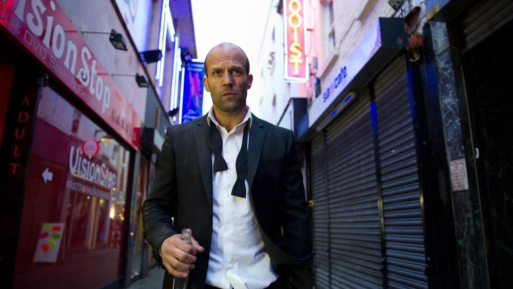 Jason Statham walks through city