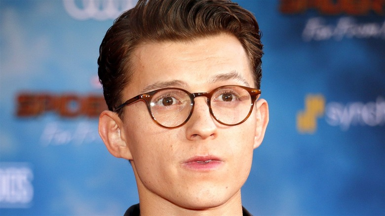 Tom Holland wearing glasses