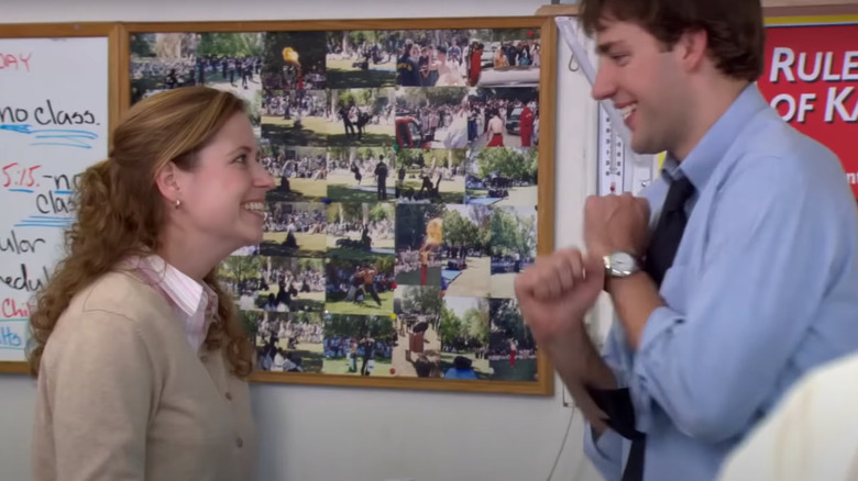 Jim and Pam smile at each other on season 2, episode 6 of The Office