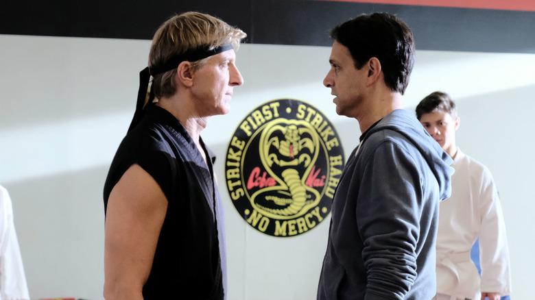 Billy Zabka as Johnny Lawrence and Ralph Macchio as Daniel LaRusso on Cobra Kai