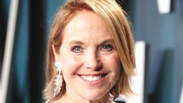 Katie Couric smiles on red carpet