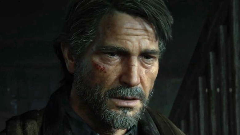Joel scratches on his face