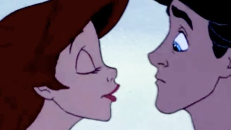 Ariel leaning in to kiss Eric