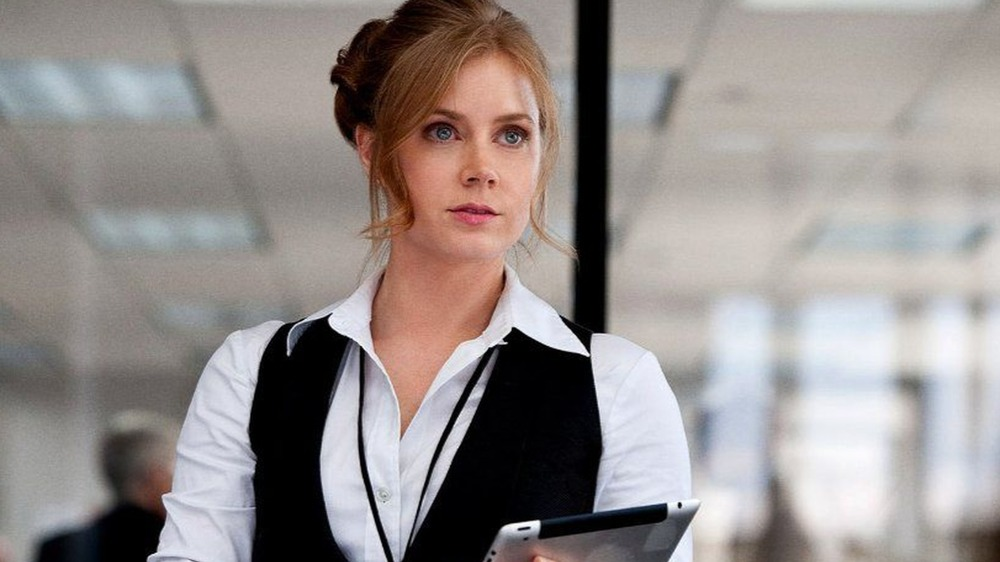 Lois Lane holding a tablet