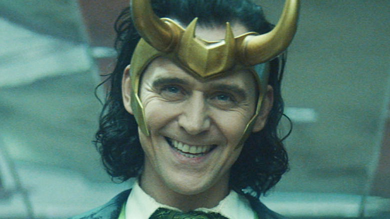 Loki smiling mischievously
