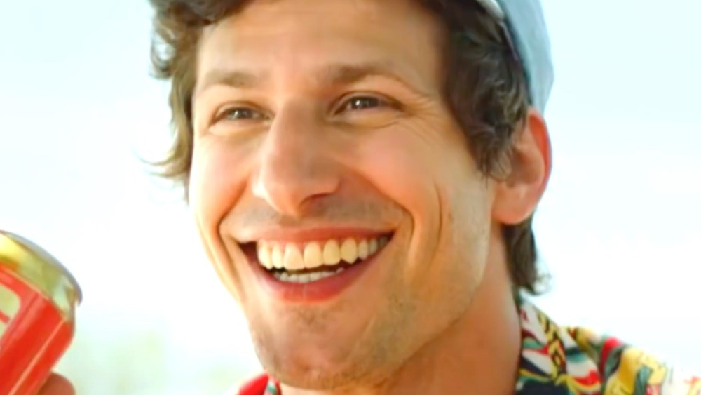 Andy Samberg with a giant grin