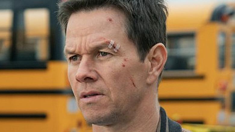Mark Wahlberg as Spenser in school bus parking lot in Spenser Confidential