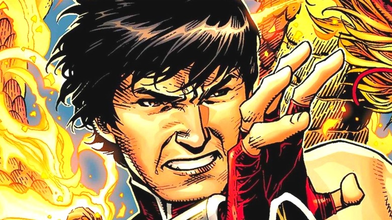 Shang-Chi standing in fire