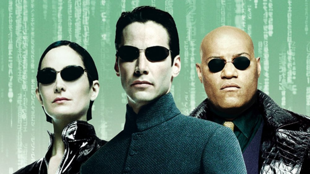 Carrie-Anne Moss, Keanu Reeves, and Lawrence Fishburne as Trinity, Neo, and Orpheus in The Matrix