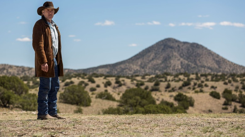 Sheriff Walt Longmire (Robert Taylor) surveys Wyoming on Longmire