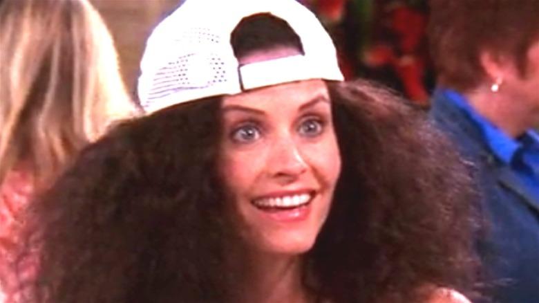 Courteney Cox Monica Geller white hat frizzy hair