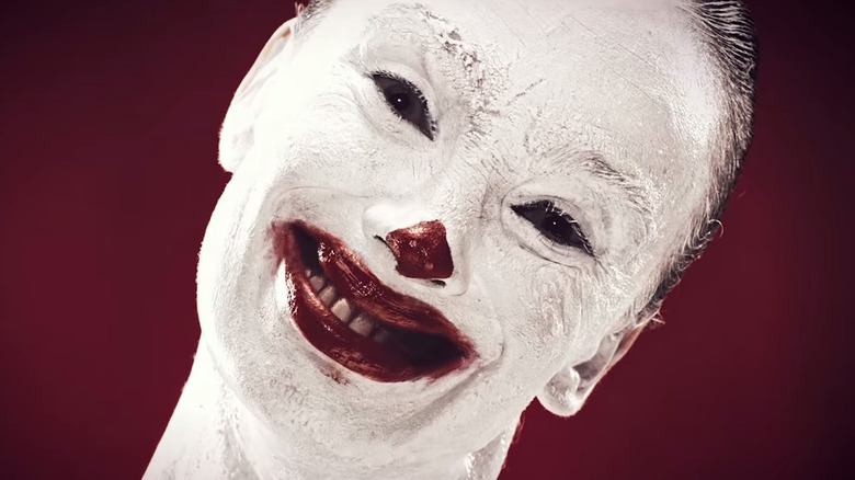 Scary clown grinning