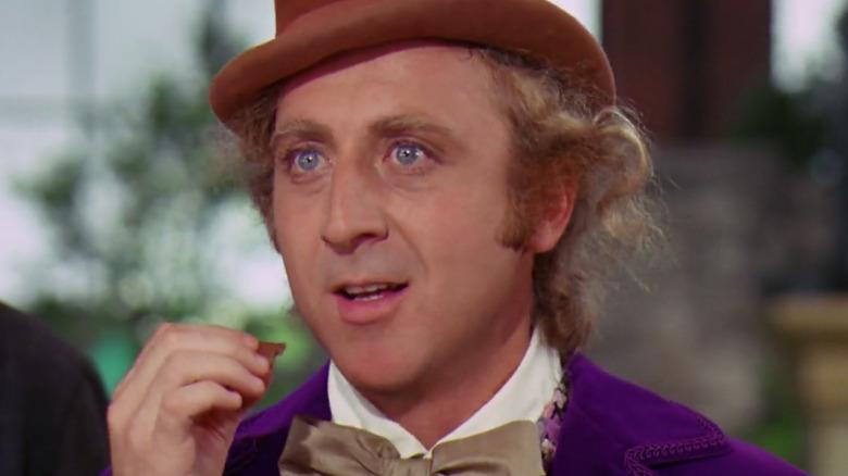 Willy Wonka watches in suspense