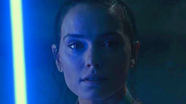 Rey with lightsaber