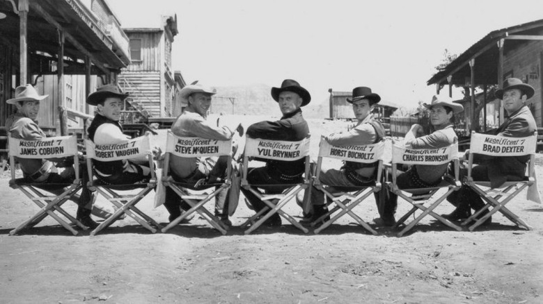 the cast of 1960's The Magnificent Seven in their actors' chairs