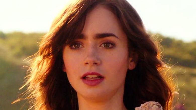 Lily Collins gasps in Love, Rosie