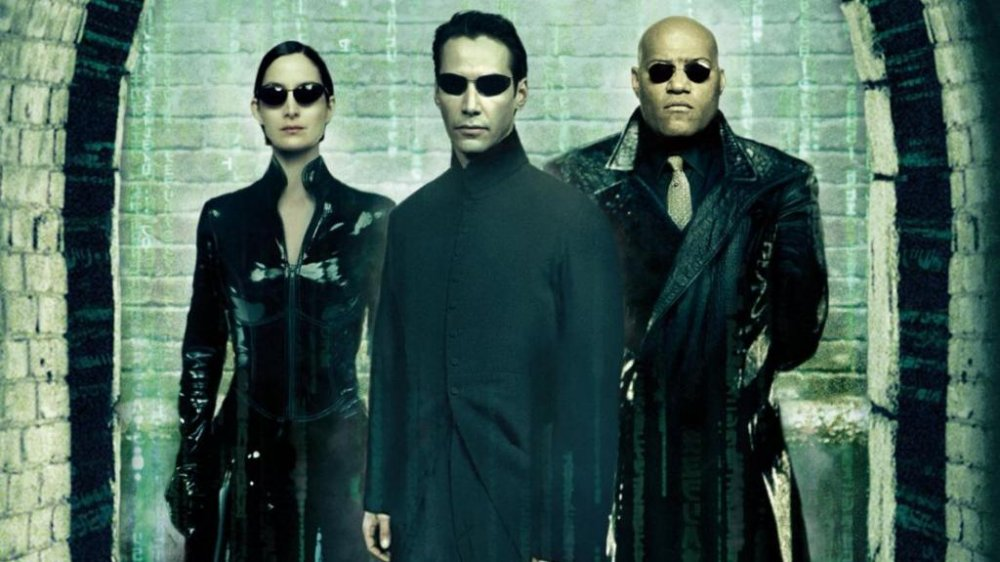 Carrie-Ann Moss, Keanu Reeves, and Lawrence Fishburne as Trinity, Neo, and Morpheus in The Matrix