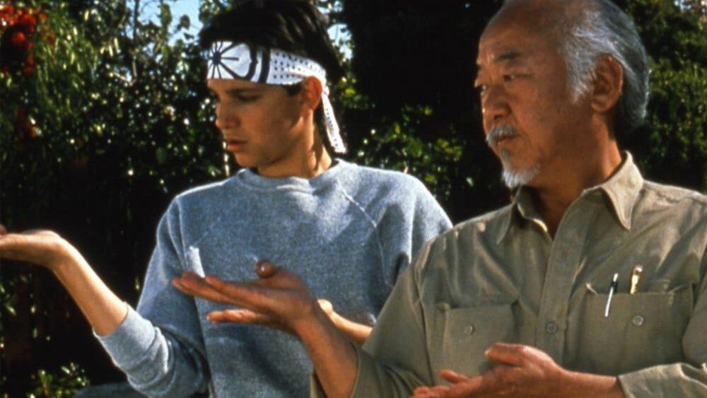 Pat Morita as Mr. Miyagi and Ralph Macchio as Daniel LaRusso in The Karate Kid