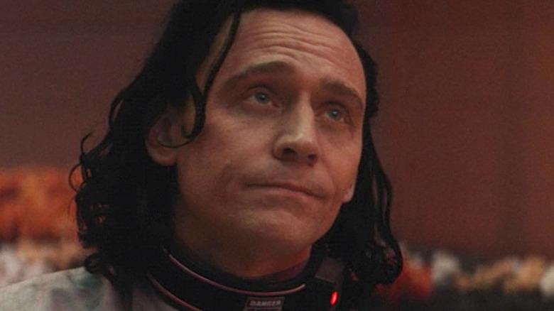 Loki looking up at Sif