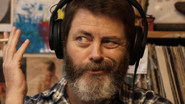 Nick Offerman wearing headphones