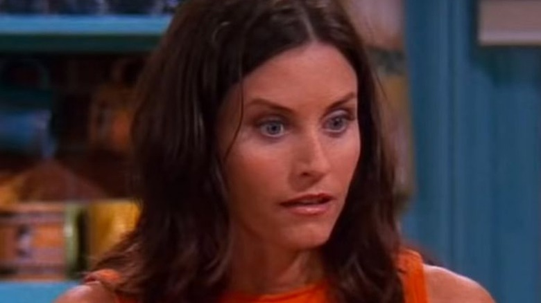 Courteney Cox playing Monica in Friends