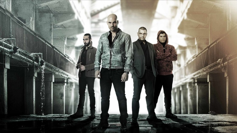 The Gomorrah cast stand in warehouse