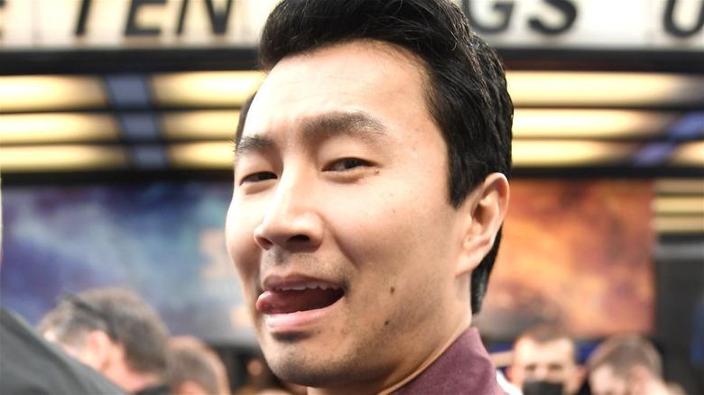 Simu Liu sticking out tongue