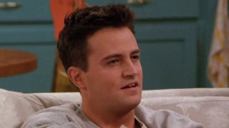 Chandler on Monica's couch