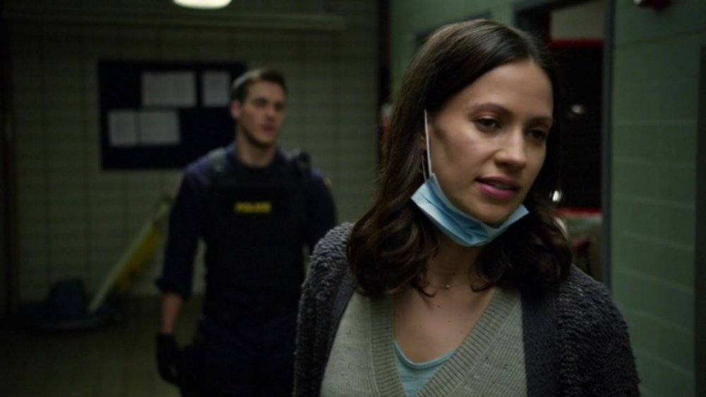 Katie (Kristen Gutoskie) wears a surgical mask on Containment