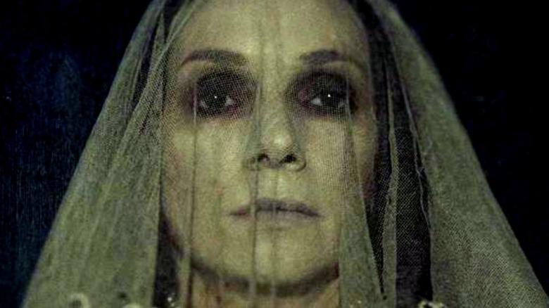 Scary veiled woman