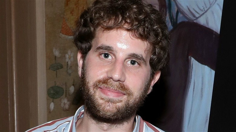 Ben Platt with curly brown hair smiles at event