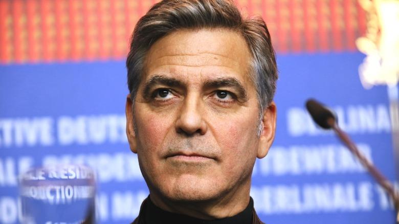 George Clooney staring grimly
