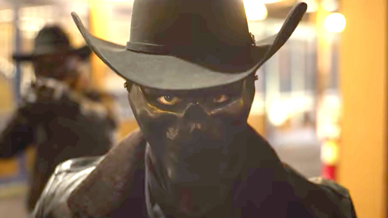 The Forever Purge cowboy looking on