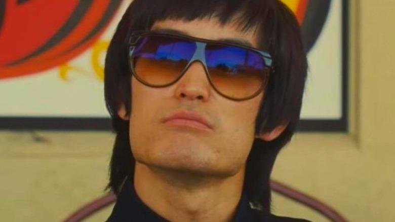 Bruce Lee wearing sunglasses